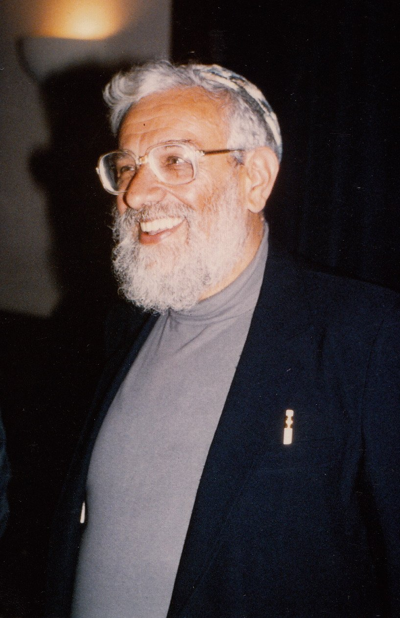Rabbi Zalman Schachter-Shalomi in black jacket and grey turtleneck, late 1980s.