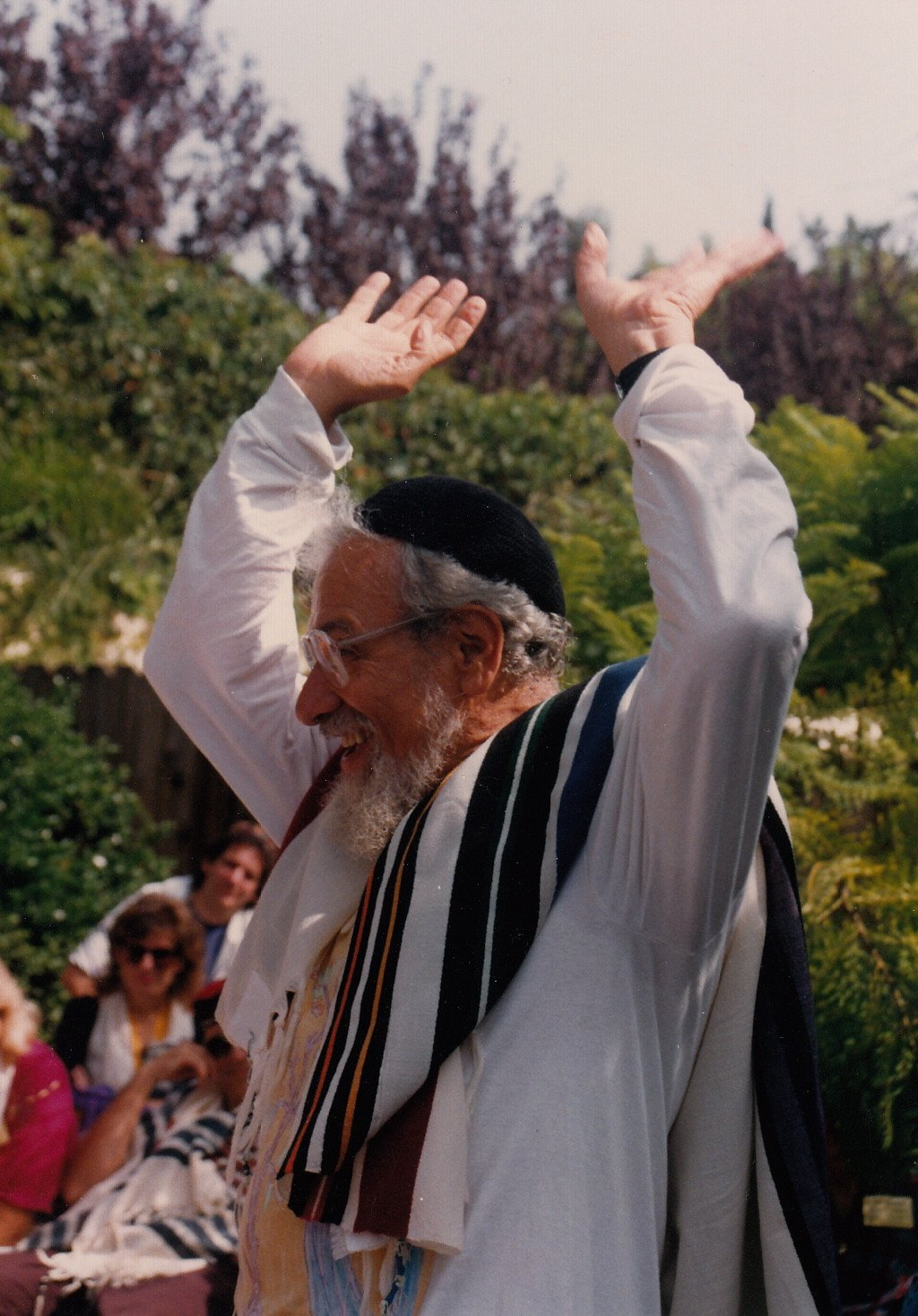 Rabbi Zalman Schachter-Shalomi with arms raised at a High Holidays service in Los Angeles, late 1990s.