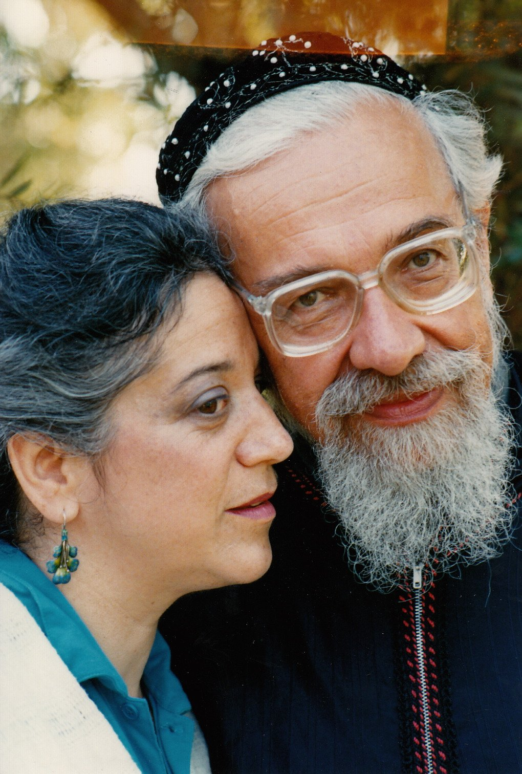 Rabbi Zalman Schachter-Shalomi (in blue robe with red stitching and pearl-embroidered kippah) with his partner, Eve Ilsen, early 1990s.
