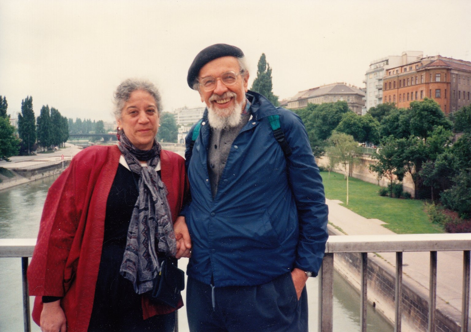 Rabbi Zalman Schachter-Shalomi and his partner, Eve Ilsen, holding hands on a bridge.