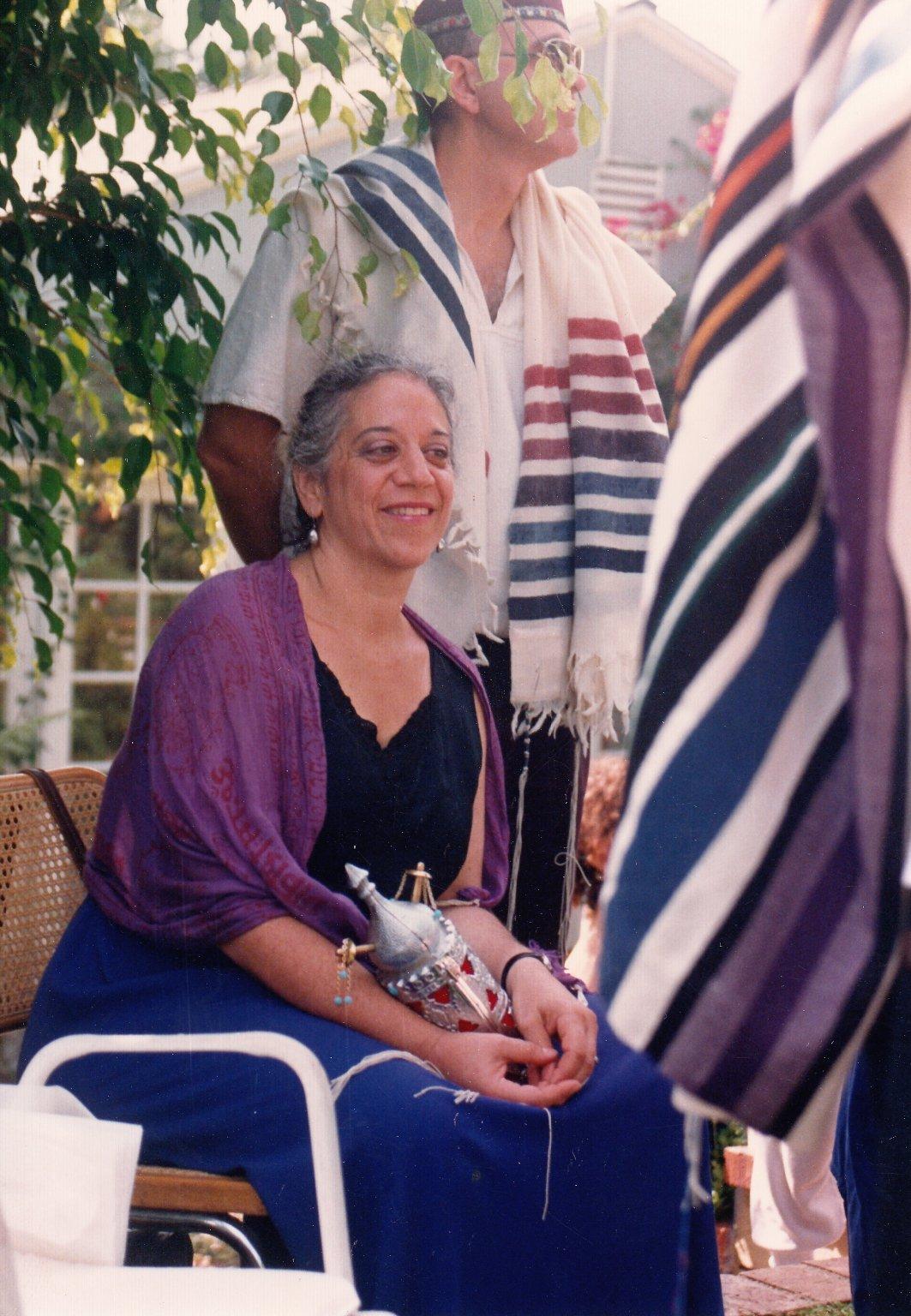 Eve Ilsen holding a small Torah scroll, 1990s.