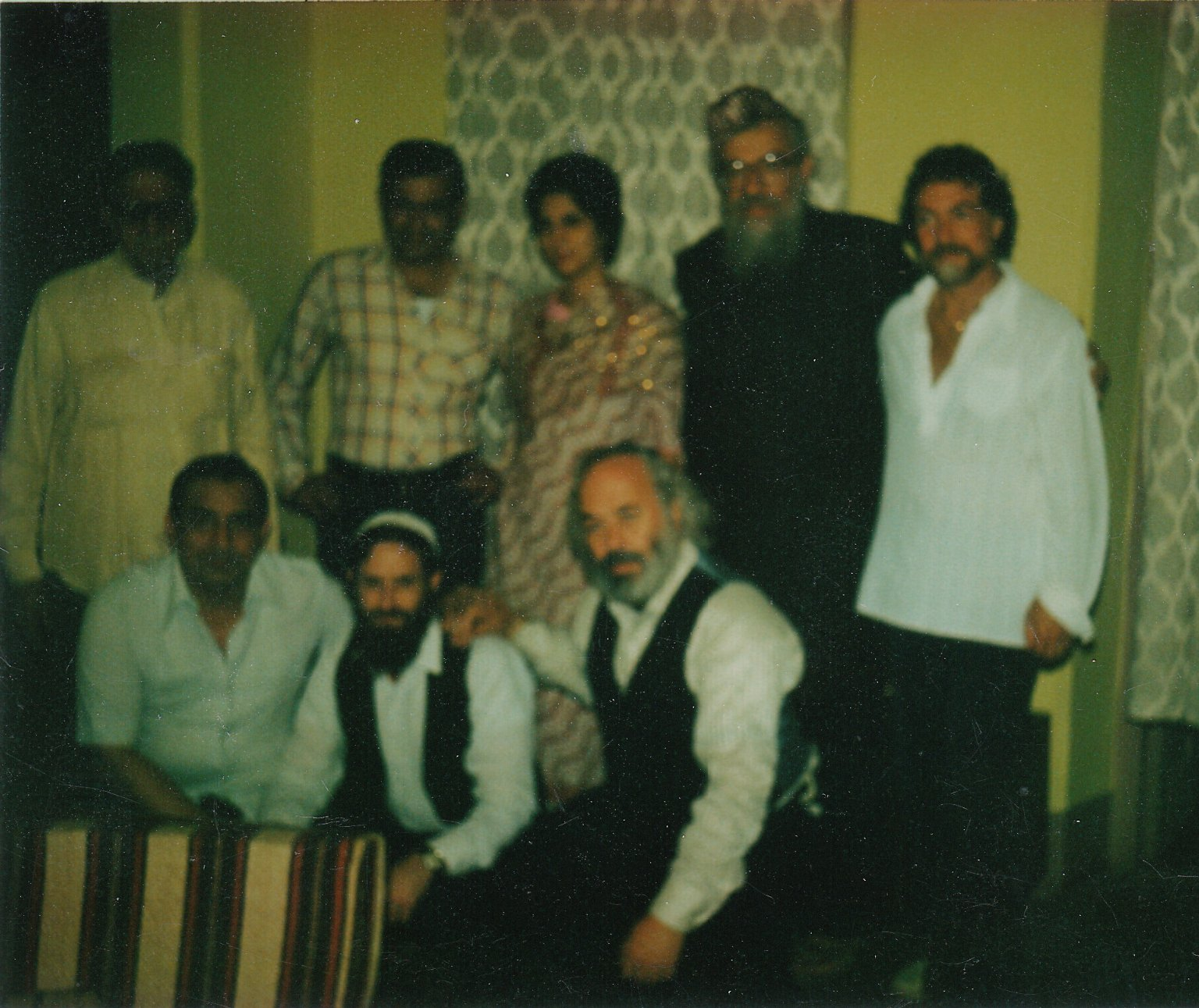 Rabbi Zalman Schachter, Paul Horn, Rabbi Shlomo Carlebach, and Rabbi David Zeller with members of the Bombay Jewish community, 1982.
