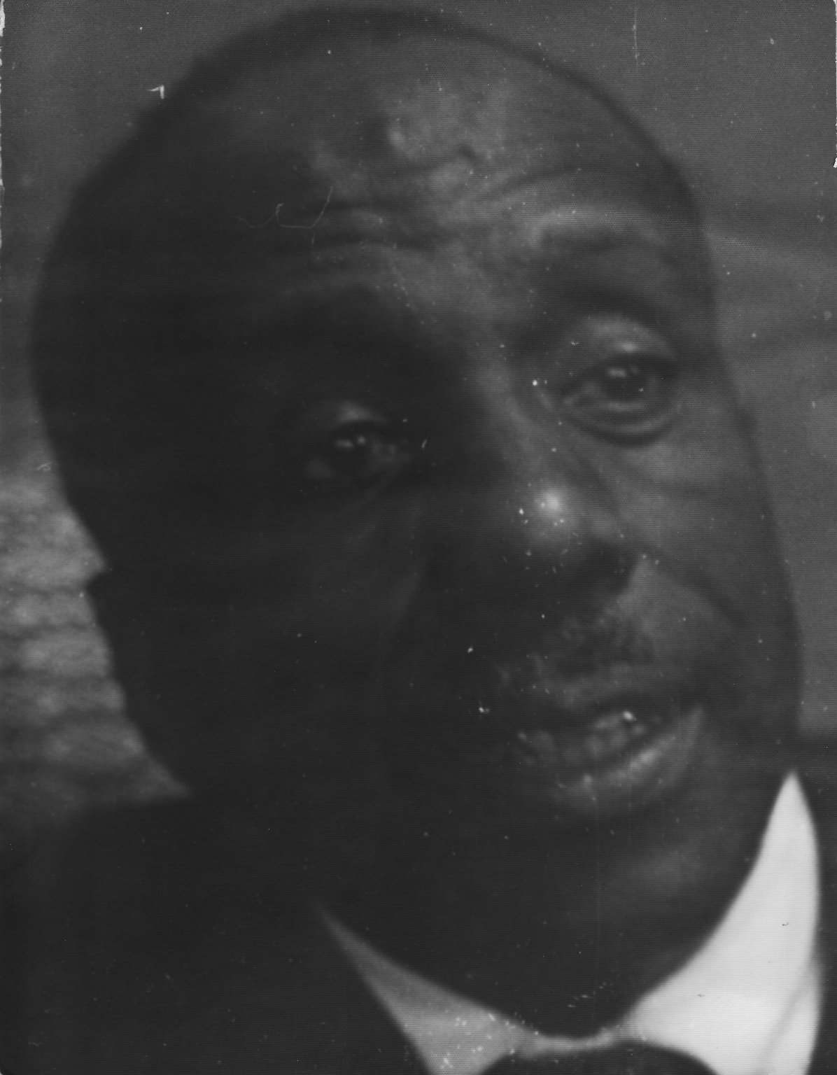 Candid photo of Reverend Dr. Howard Thurman in the office of Rabbi Zalman Schachter at the Hillel House of the University of Manitoba, Winnipeg, Manitoba, Canada, ca. 1960.