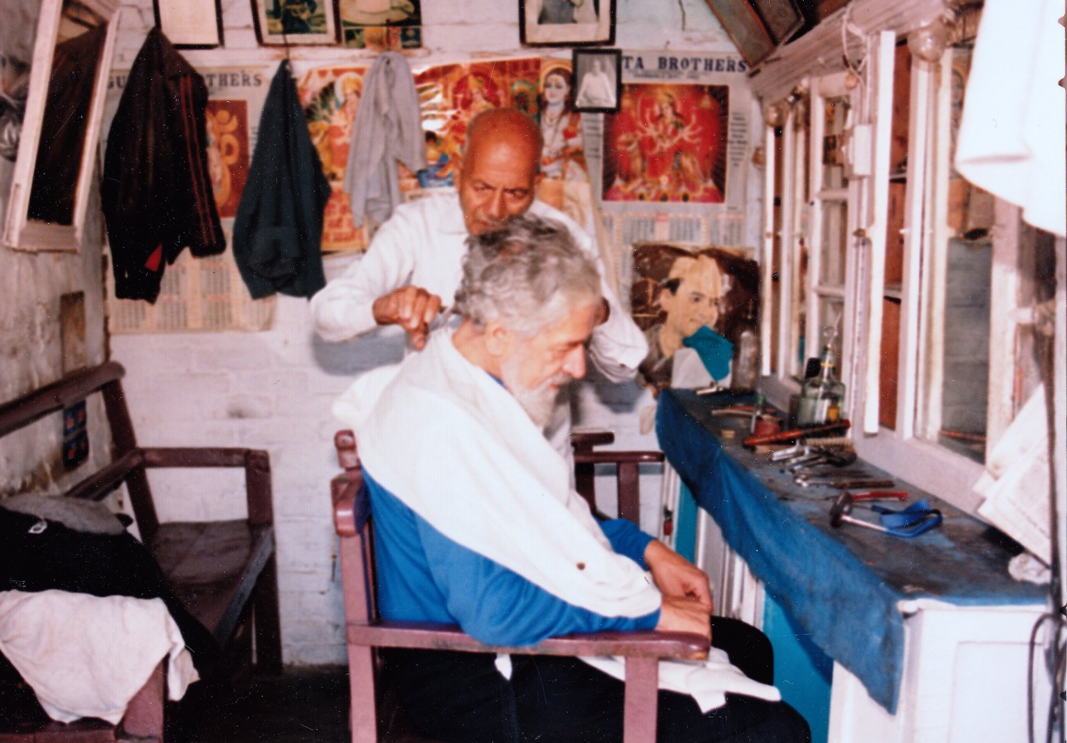 Rabbi Zalman Schachter-Shalomi getting a haircut from a barber in India, Fall 1990.