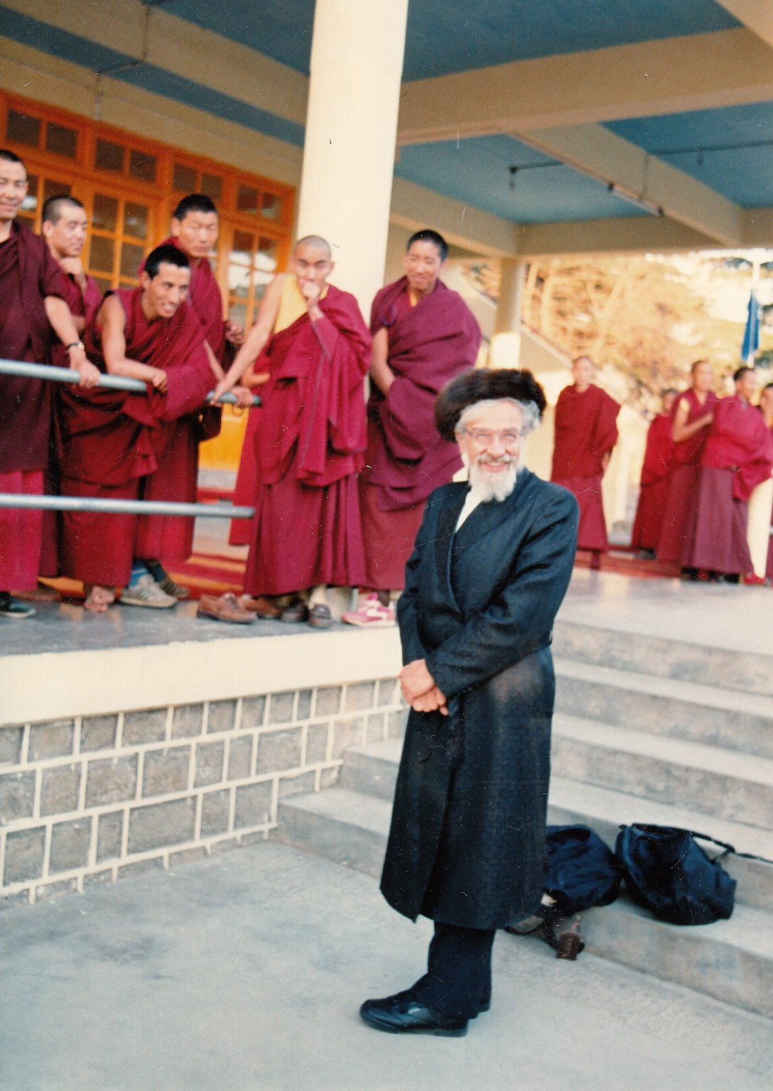 Rabbi Zalman Schachter-Shalomi in Hasidic strimel and bekeshe with a group of Tibetan Buddhist monks, Fall 1990.