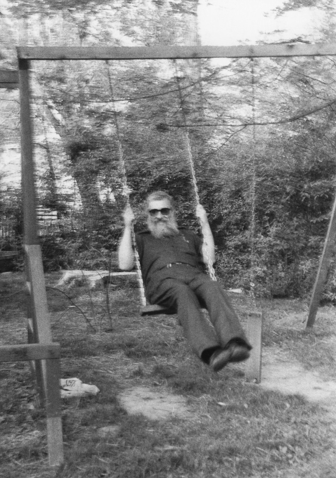 Rabbi Zalman Schachter on a swing, Fall 1990.