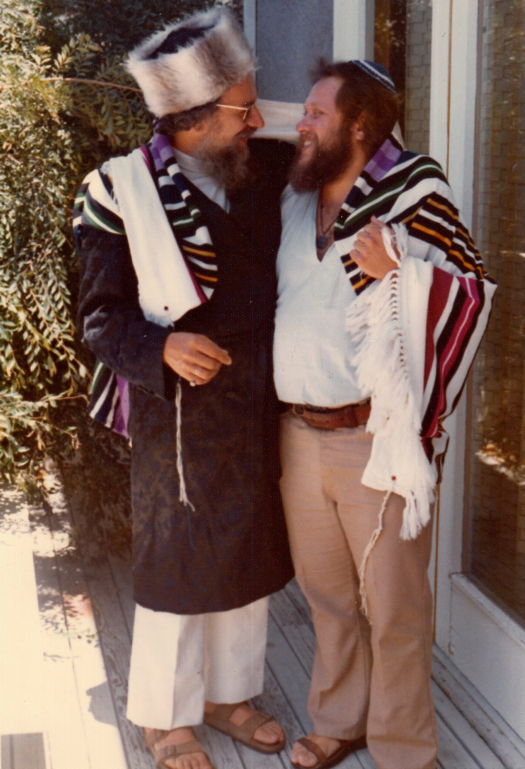 Rabbi Zalman Schachter in white and grey strimel and a bekeshe with Barry Barkan, June 8, 1974.
