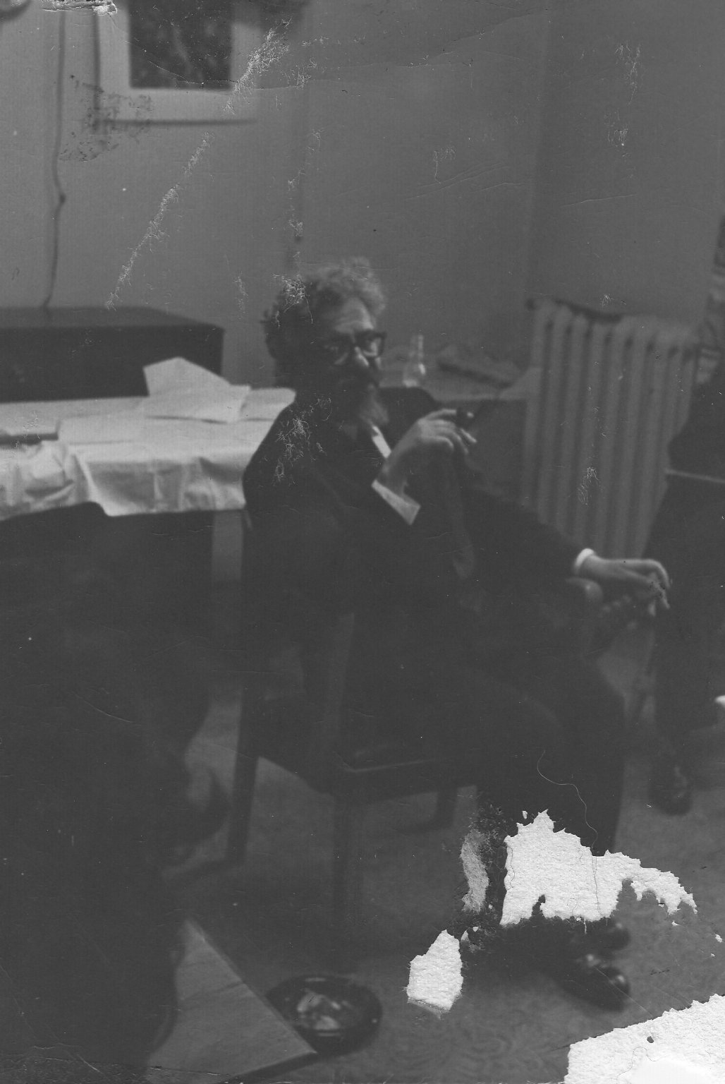 Rabbi Abraham Joshua Heschel smoking a cigar.
