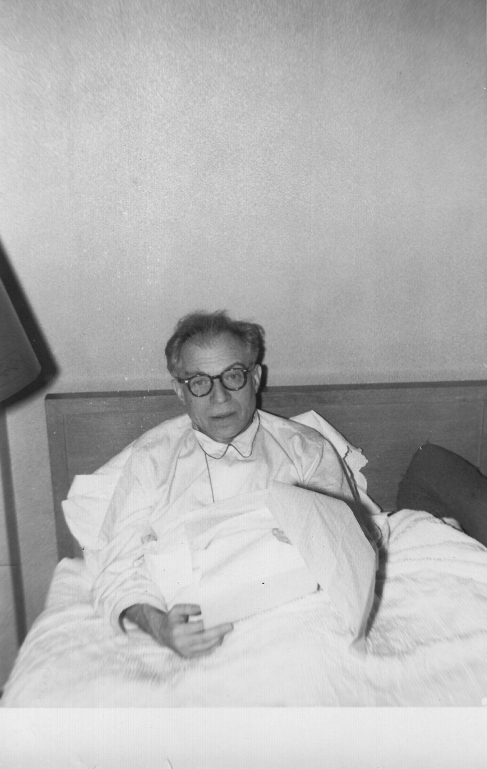 Rabbi Maurice A. (Moshe) Pekarsky reading in his bed shortly before his death.