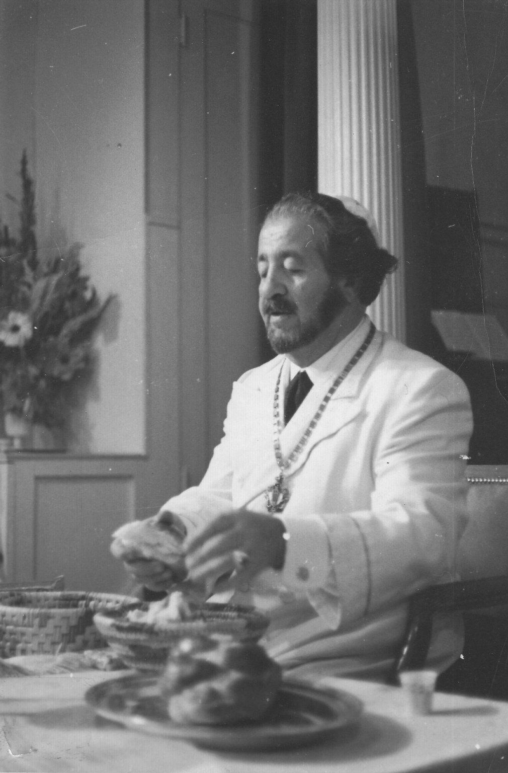 Rabbi Joseph Gelberman tearing hallah.