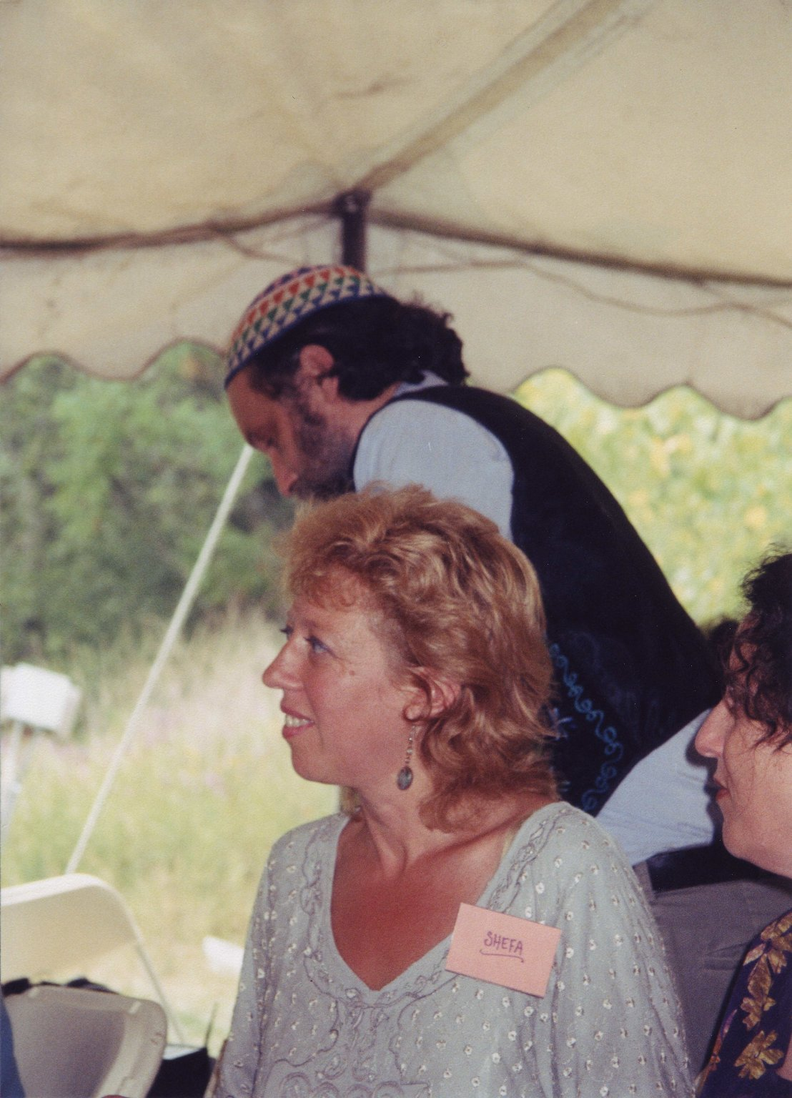 Candid photo from Rabbi Zalman Schachter-Shalomi's 75th birthday celebration at Elat Chayyim, ca. 1999. Digital photo scanned at 800dpi and cropped to photo area.
