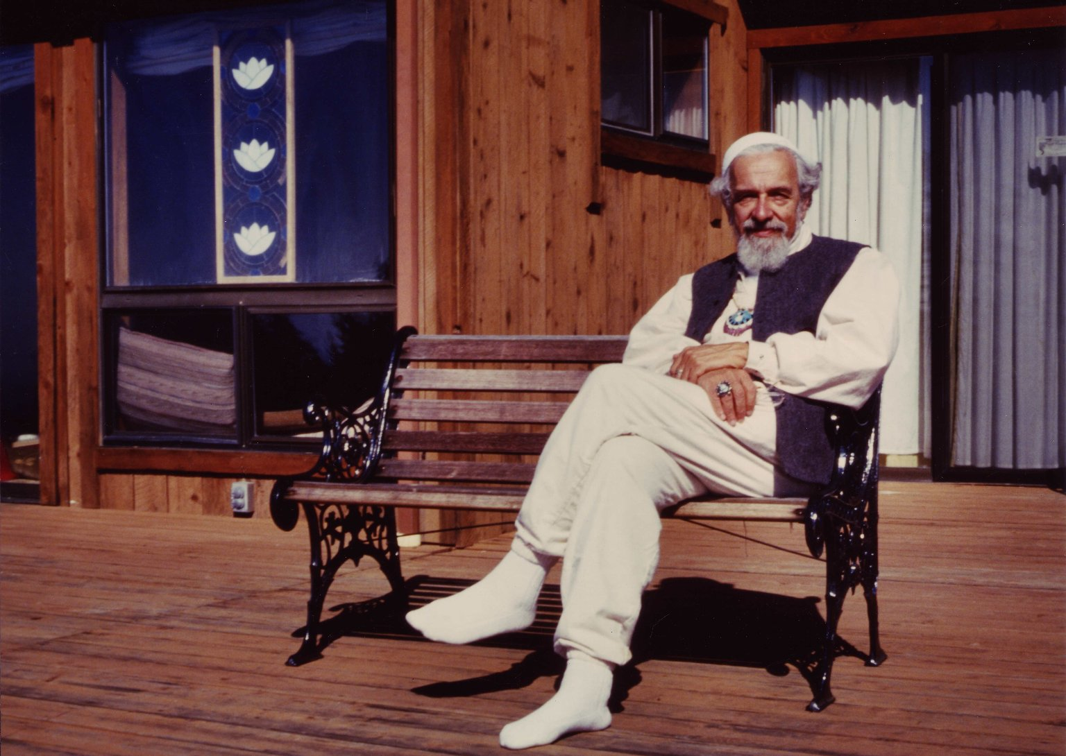 Rabbi Zalman Schachter-Shalomi seated on a bench at the Mount Madonna Center, ca. 1999.