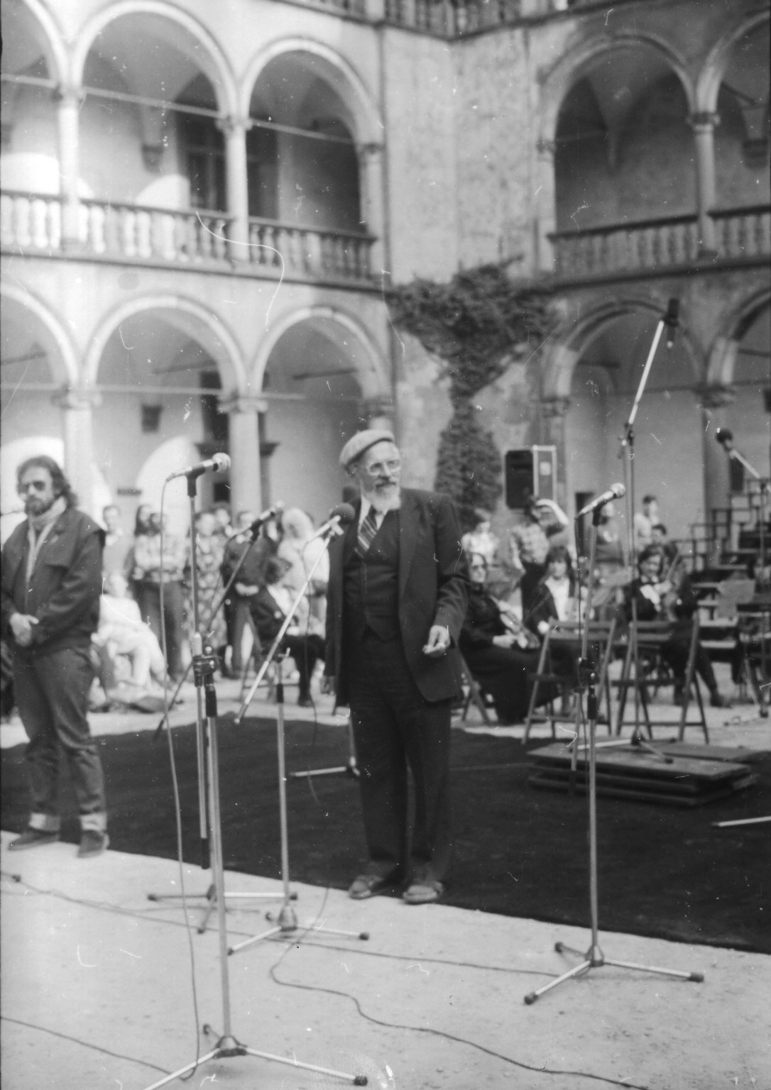 Rabbi Zalman Schachter-Shalomi speaking at the Festival of the Spirit in Krakow, Poland, with an unidentified man, possibly his translator, on the left, ca. 1985.