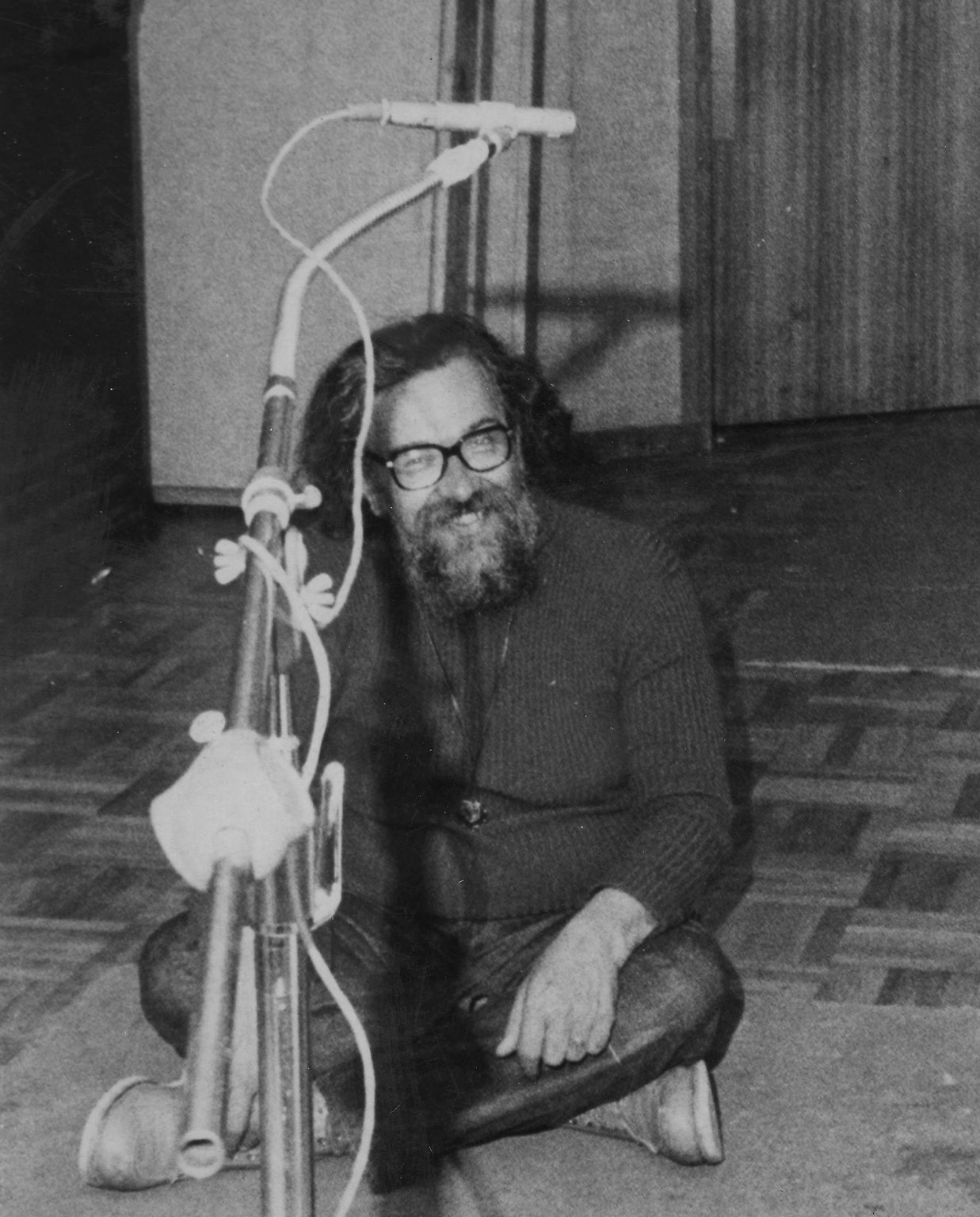 """Rabbi Zalman Schachter sitting in front of a microphone, taking a break and from recording the """"Tale of the Seven Beggars"""" album in Coupe Studios, Boston, Massachusetts, ca. 1972."""