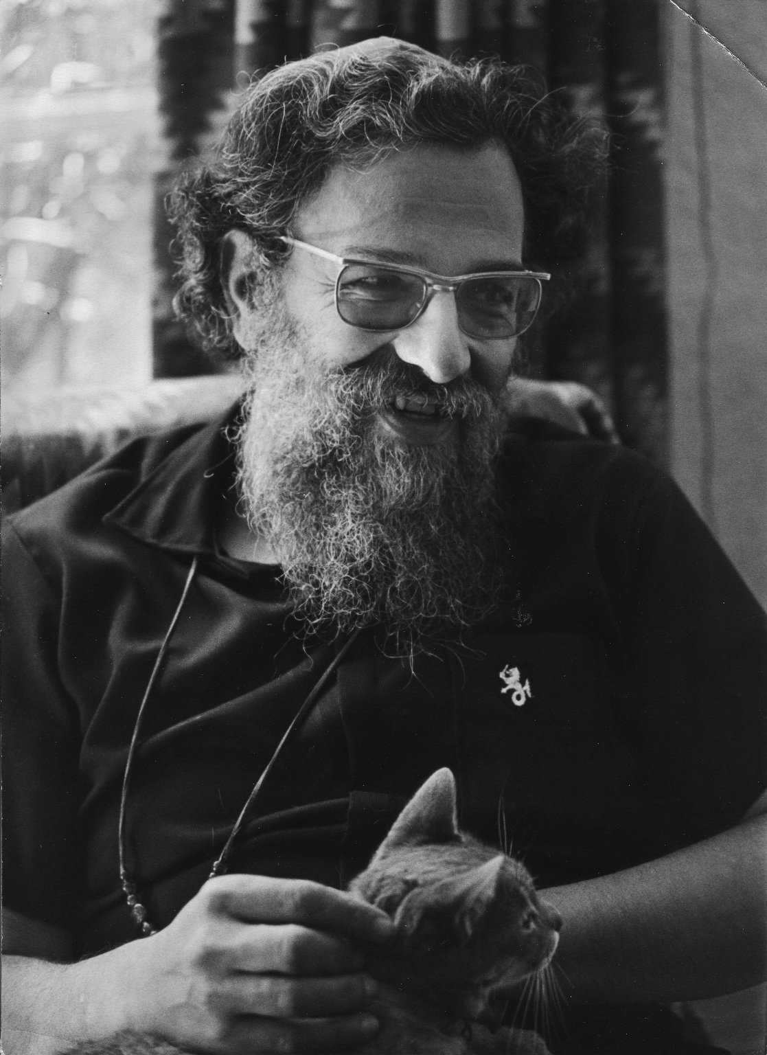 Rabbi Zalman Schachter with a cat in his lap, ca. 1975.