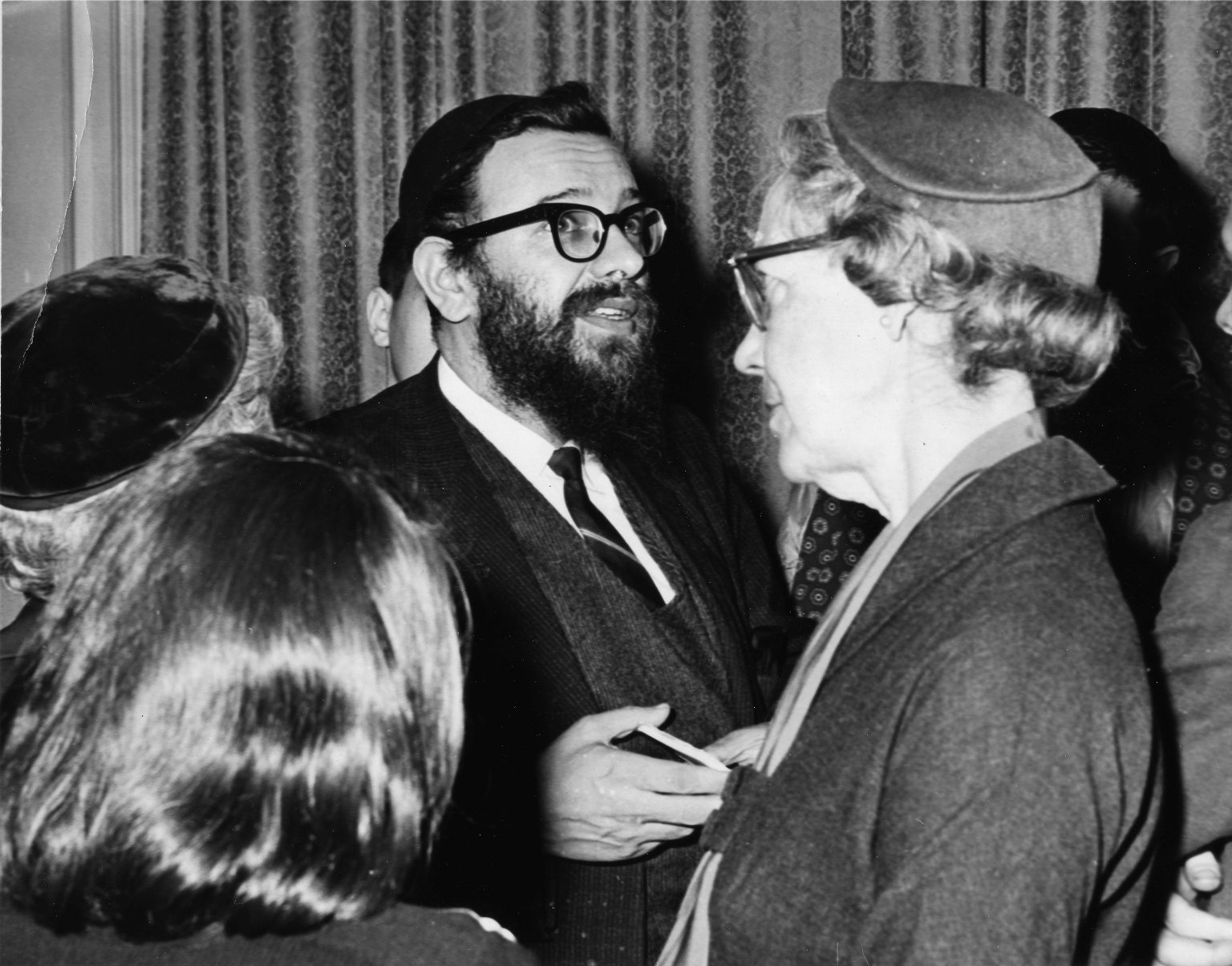 Rabbi Zalman Schachter speaking to people after a Hillel Foundation talk in Pittsburg, Pennsylvania in 1962 or 63.