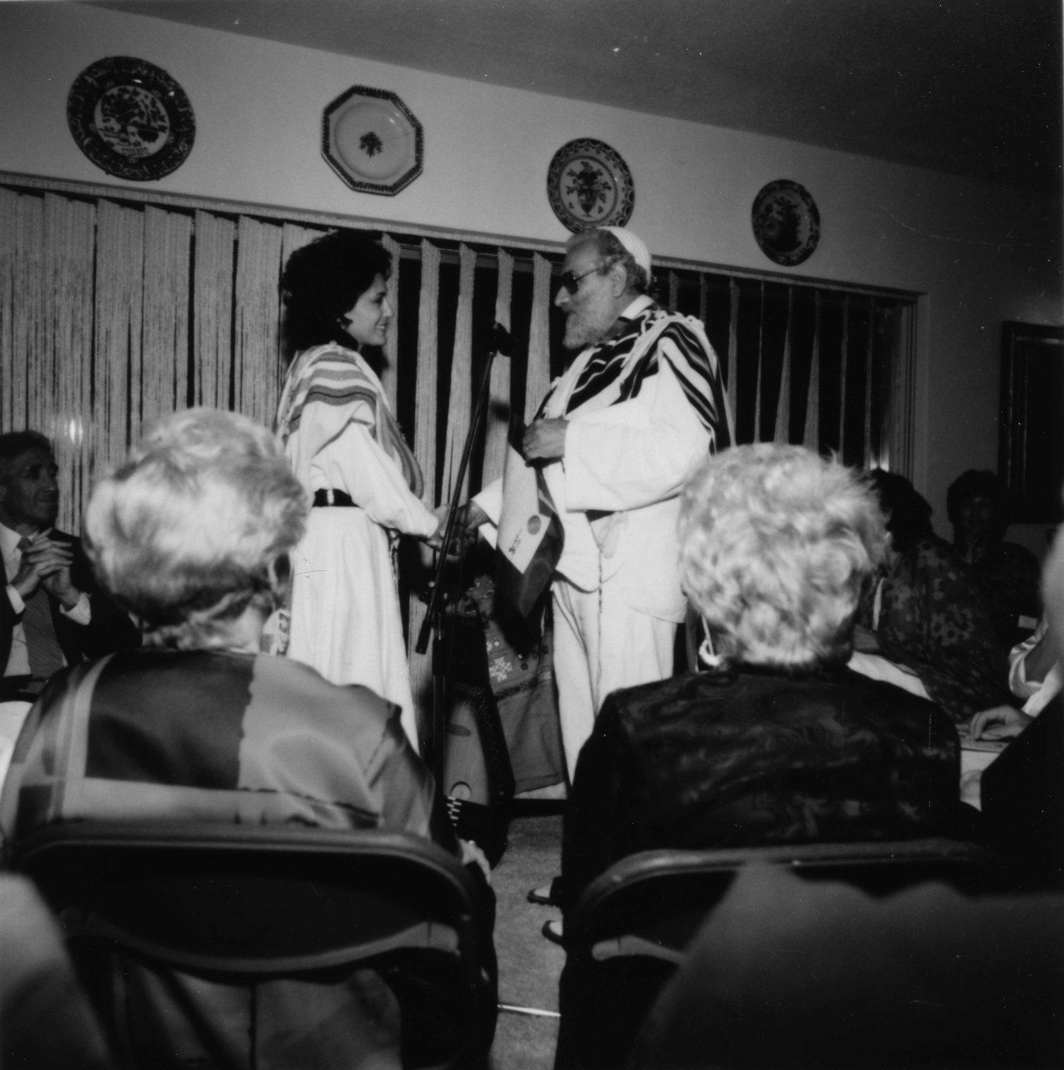 Rabbi Zalman Schachter-Shalomi ordaining Rabbi Shoni Labowitz, ca. 1985.