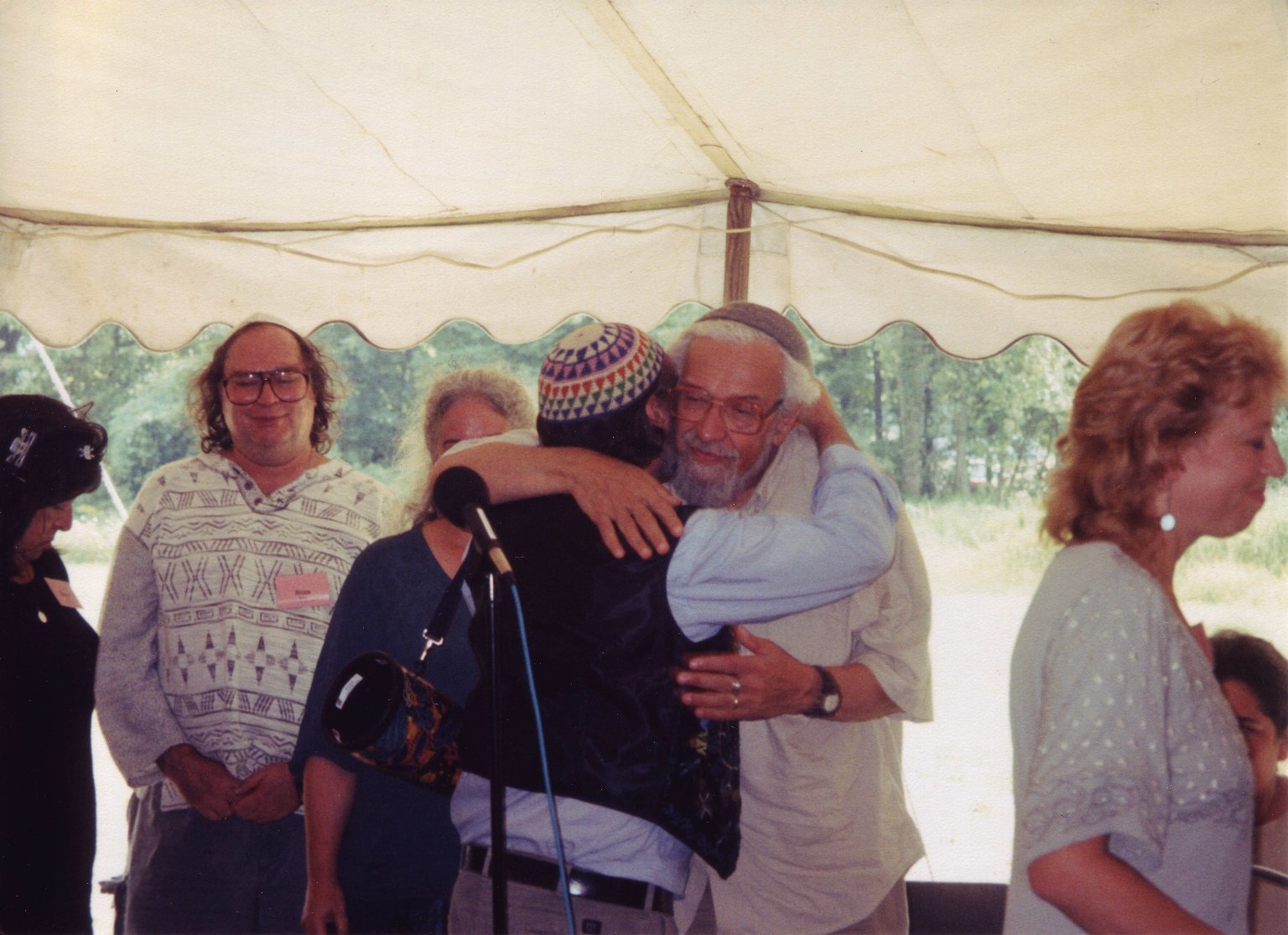 Cantor Robert Michael Esformes embracing Rabbi Zalman Schachter-Shalomi at his 75th birthday celebration at Elat Chayyim, ca. 1999.