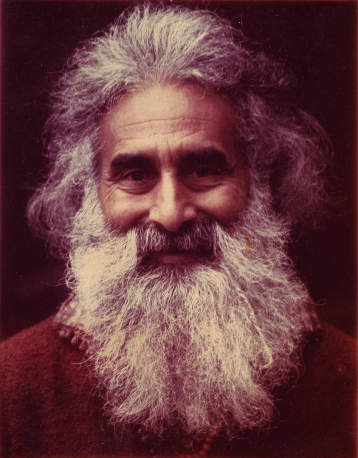Pir Vilayat Inayat Khan in a rust colored robe, ca. 1965.
