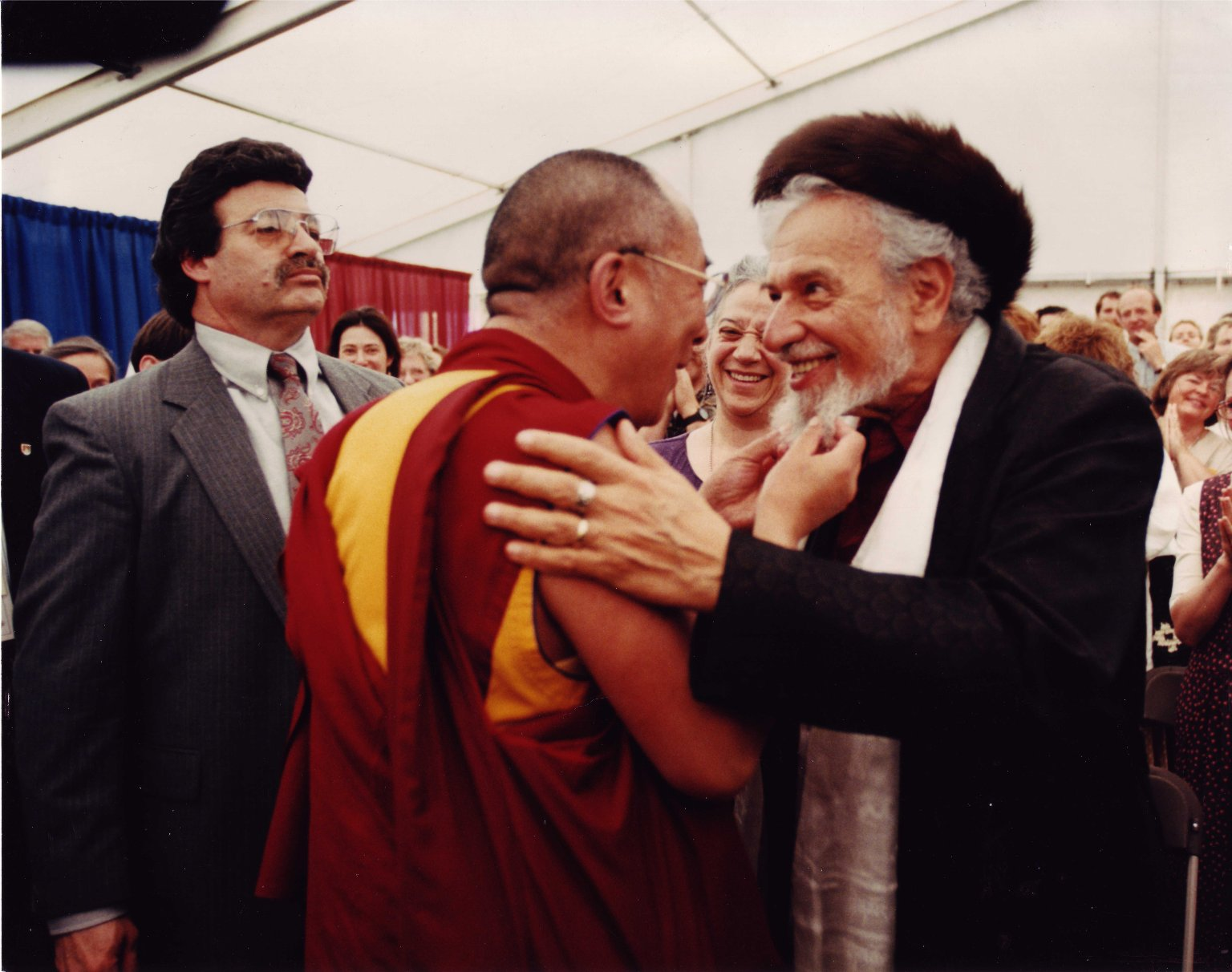 Tenzin Gyatso, the 14th Dalai Lama, greeting Rabbi Zalman Schachter-Shalomi in shtreimel and bekeshe at the Naropa Institute, during the Spirituality and Education Conference in 1997.