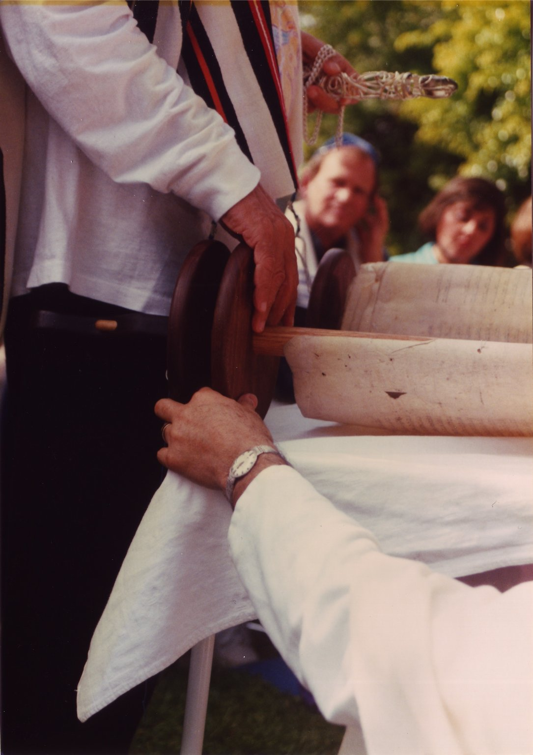 Rabbi Zalman Schachter-Shalomi reading from a Torah scroll (at Fellowship House Farm or B'nai Chorin).