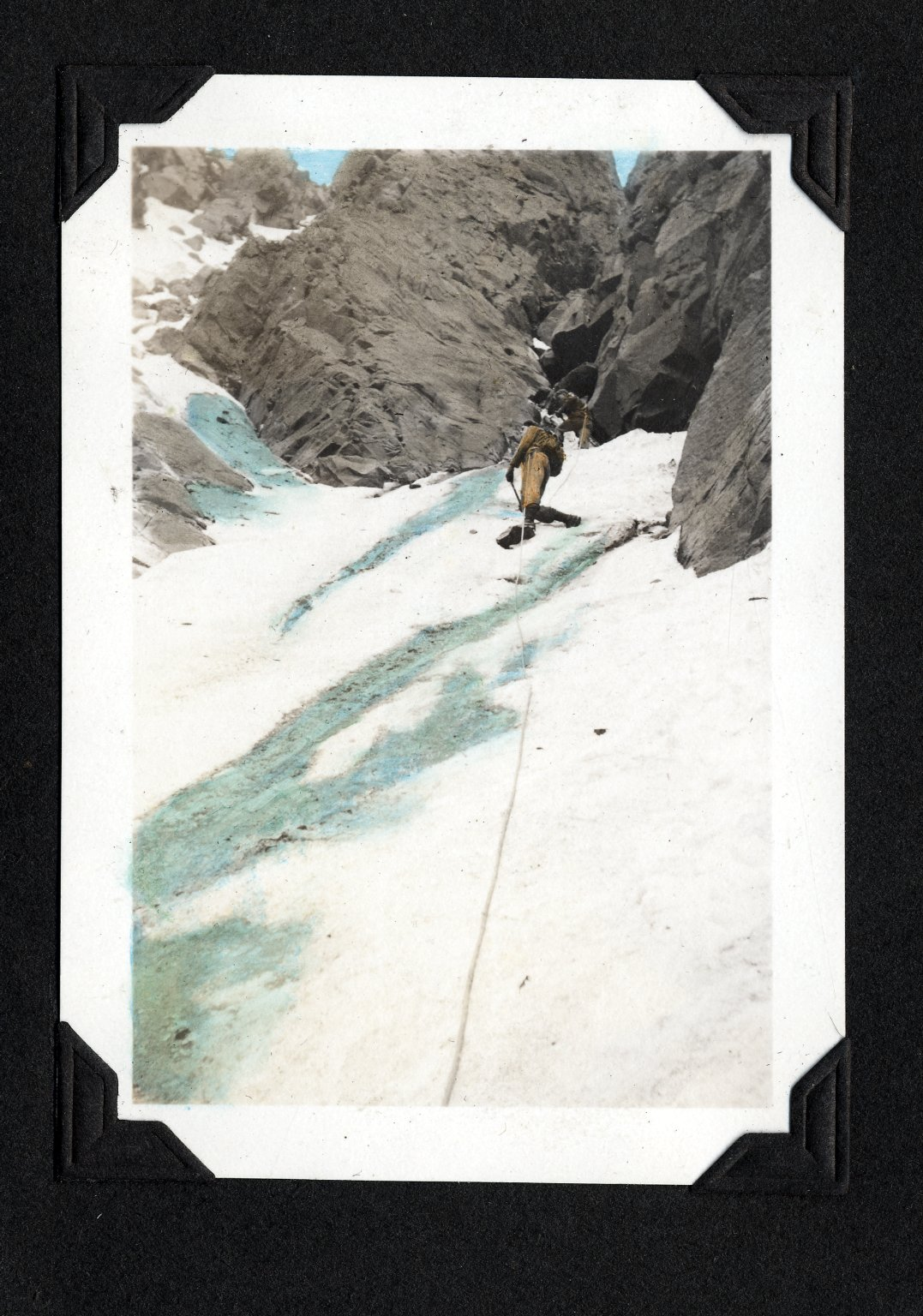 Climber on steep ice face