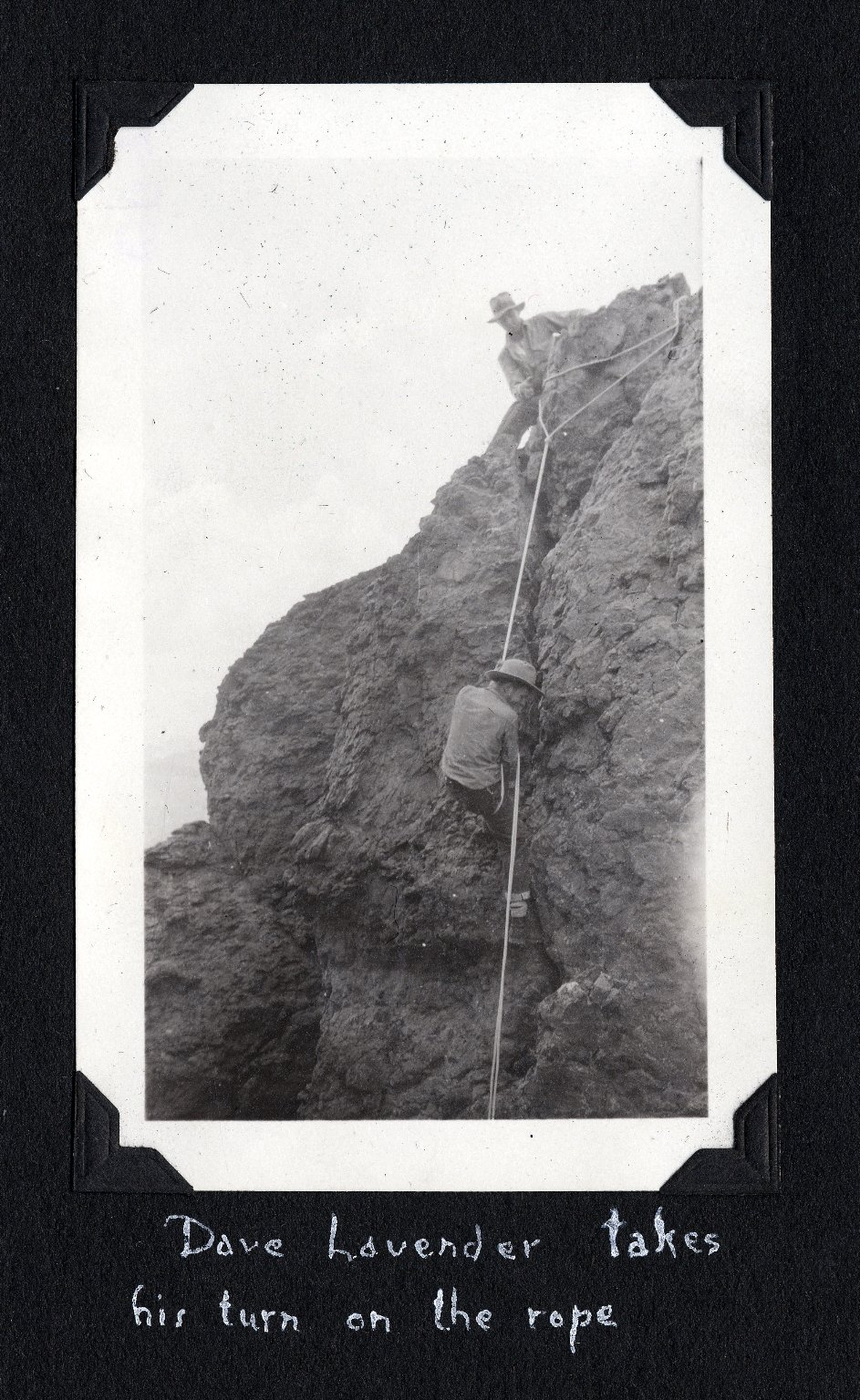 David Lavender climbing rope to Coxcomb Peak
