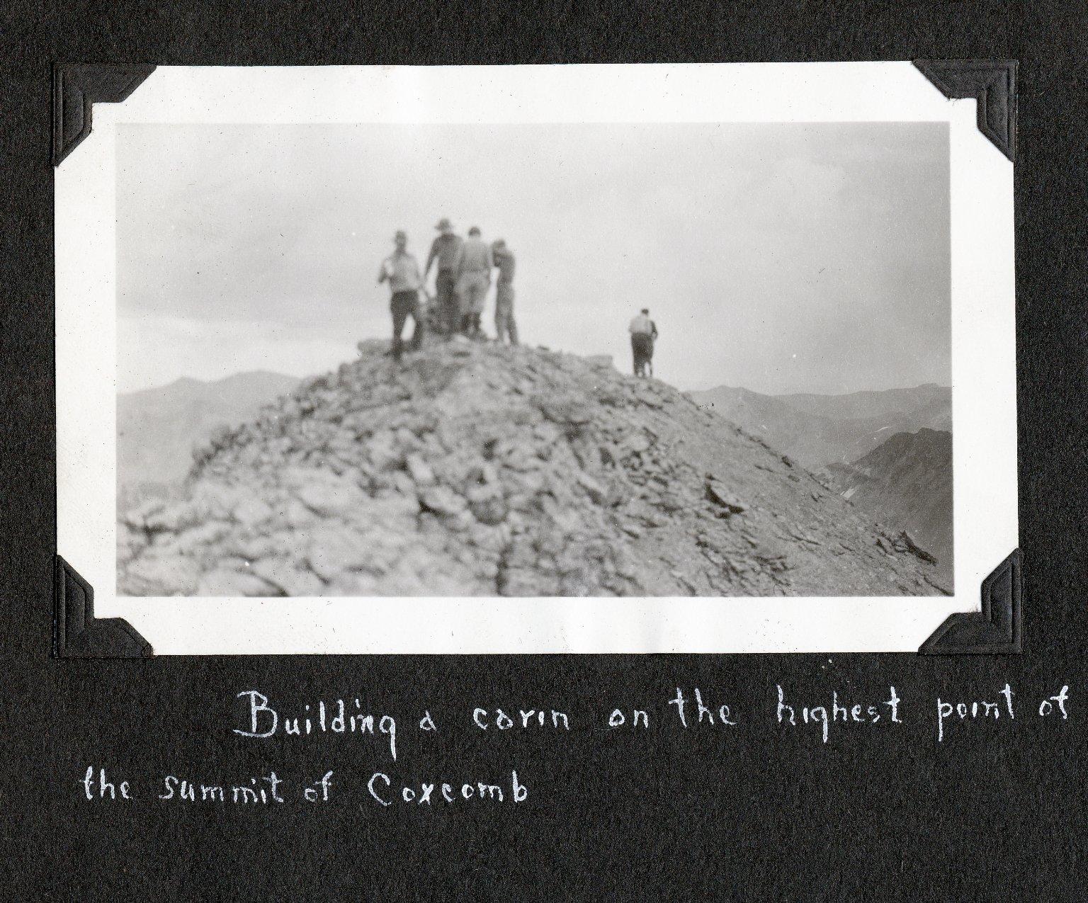 Building a cairn at Coxcomb Peak