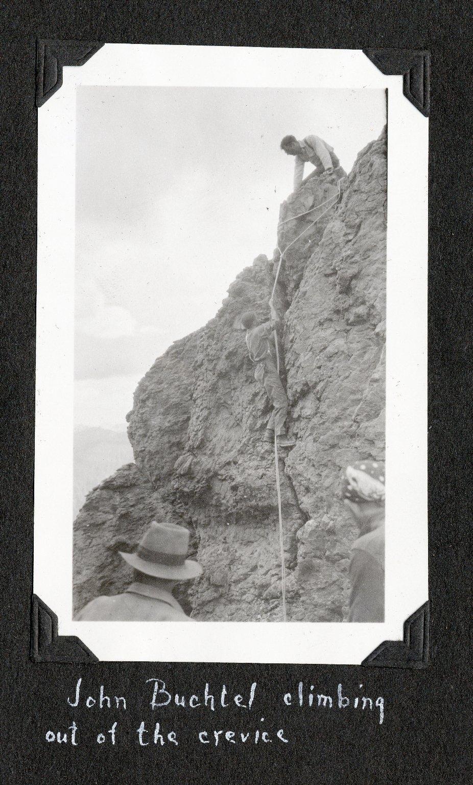 John Buchtel climbing out of the crevice at Coxcomb Peak