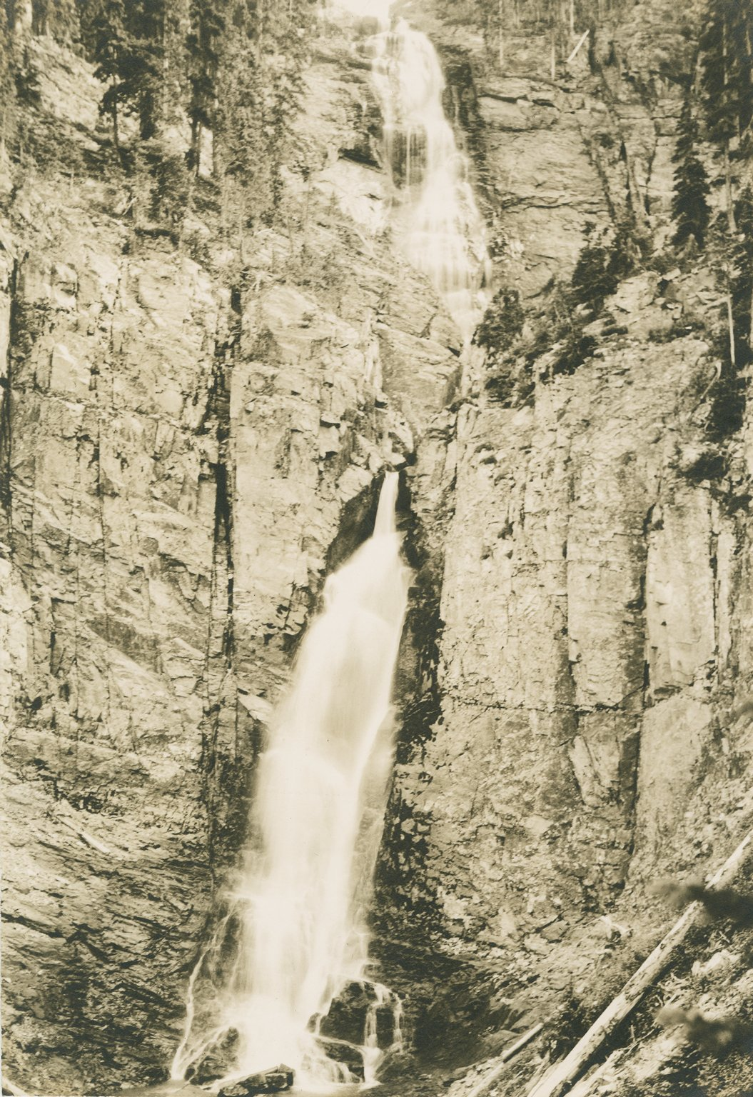 Untitled photo of a 2-tiered waterfall down a sheer rock face.