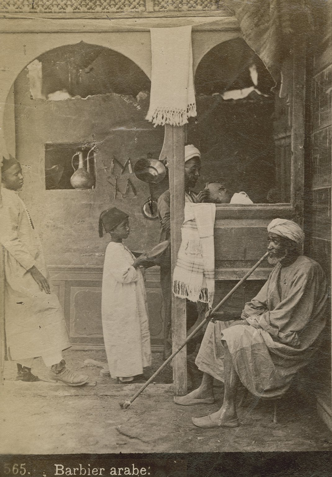 Street barber and man with pipe.